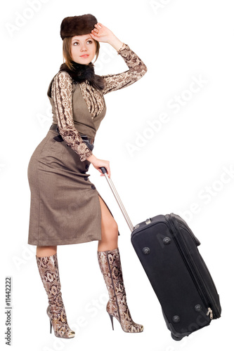 Young lady with a suitcase. Isolated on white