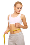 Sporty beautiful girl is measuring her waist on white poster