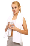Portfait of Sporty beautiful girl holding glass of water poster