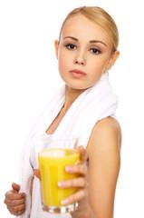 Portfait of Sporty beautiful girl holding glass of juice
