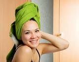 Fototapety beautiful woman with a towel on her head