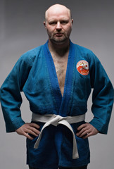 man in dark blue kimono