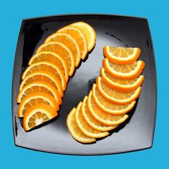 orange segments on black plate