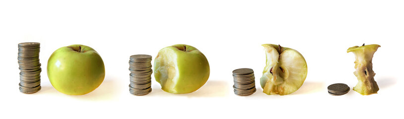 rouleaus of coins and apple