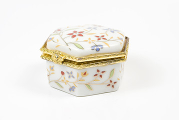 White box with costume jewellery and ornaments