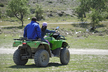 Father and Daugther are driving the ATV
