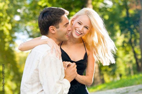 Young happy smiling couple walking outdoors together