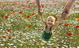 flying baby on flowers background