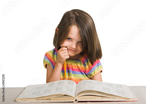 little girl studying from book
