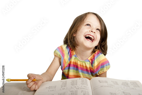 little girl having fun studying