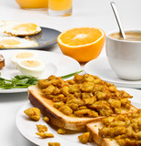 scrambled eggs on toast, boiled eggs, orange and coffee poster