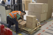 Warehouse operative moving stock from pallet