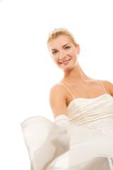 Beautiful bride dancing with veil