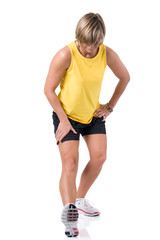Full isolated picture of a  caucasian woman stretching the leg