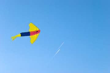 Kite against two flying planes