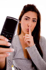 portrait of woman with cell phone instructing to be silent