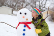 Cute Young Girl Kisses Snowman
