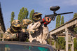 Paintball players on the car