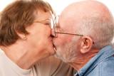 Affectionate Senior Couple Kissing poster