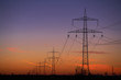 Strommasten zum Sonnenuntergang