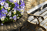Planter with pansies and bench