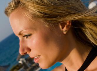 blonde female looking into sun in resort