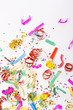 confetti and colorful blowers on white background