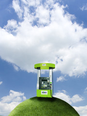 Fuel pump on top of grassy globe