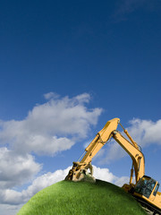 Excavator digging on grassy globe