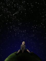Boy looking at stars