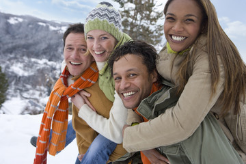 Portrait of happy couples in winter setting