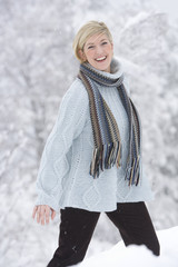Happy mid adult woman in snow