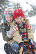 Portrait of young boy and girl sledding