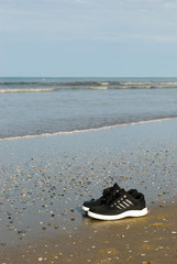 Sneakers near the sea