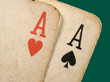 2 old dirty aces poker cards close up.