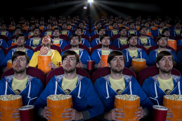 Cloned audience watching movie in theater