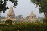 Ancient Hindu Temples in Gardens at Khajuraho, India. poster