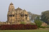 Ancient Hindu Temple in landscaped gardens at Khajuraho poster