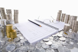 Accounting ledger between piles of coins poster