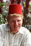 man wearing a fez. poster