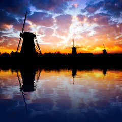 Dutch windmills with reflection on the water