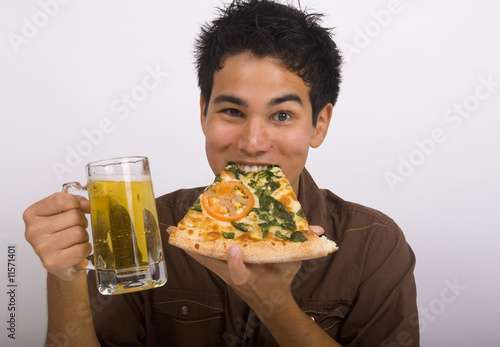 man enjoys a glass of beer and a slice of pizza