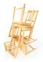 Stacked wooden chairs