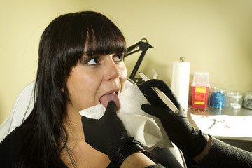 Girl getting ready to get her tongue pierced