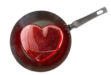 Ffrying pan with the big red heart. -Fried heart. Isolated