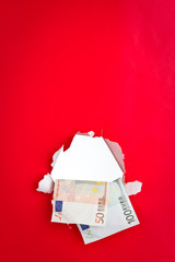 Euro money on red background