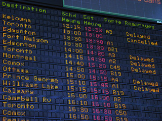Canadian airport information board, domestic departures.