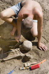 Archaeologist excavating prehistoric grave
