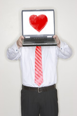Businessman Holding Laptop with heart