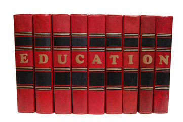 "red books in a row with the words ""education"". Isolated."